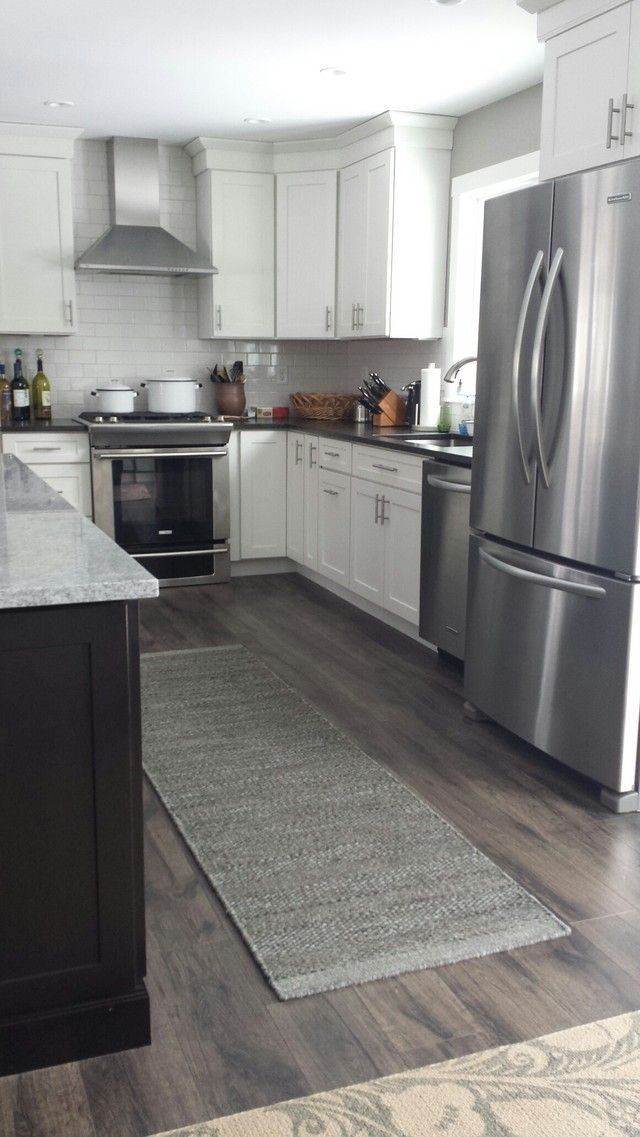 Hardwood vs laminate wood flooring what should you for Grey floor black cabinets
