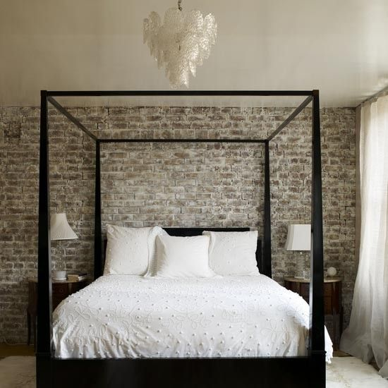 Four poster beds brick walls bedroom make a feature out of bare brick walls