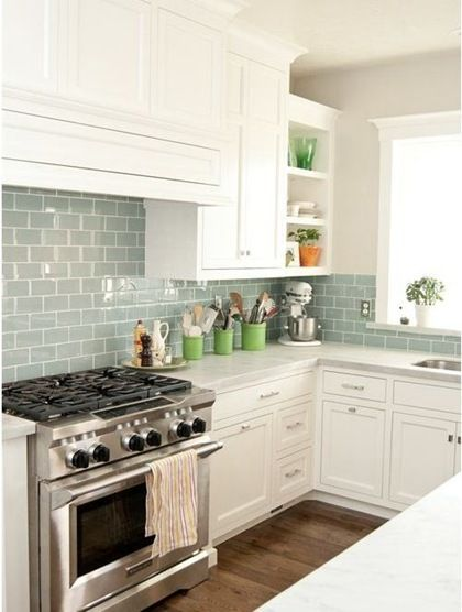 lovely colored subway tile backsplash kitchen with the white cabinets
