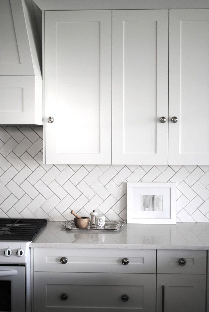 Remodeling subway tiles backsplash white tile pattern glossary laid in a herringbone pattern - Subway tiles in kitchen pictures ...