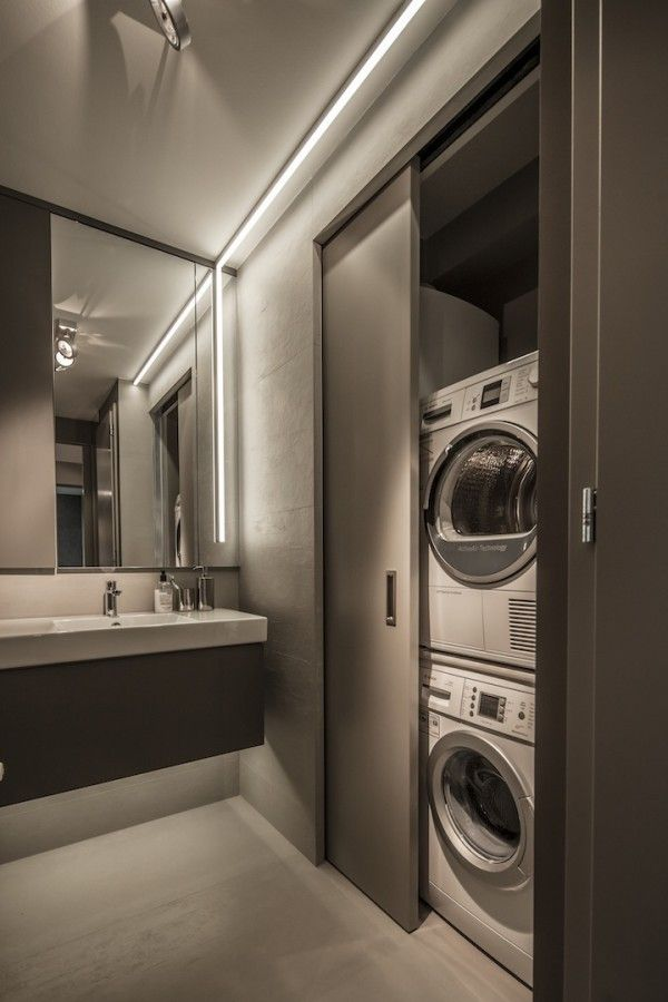Small bathroom design hide a washer and dryer behind a for Small bathroom designs with washing machine