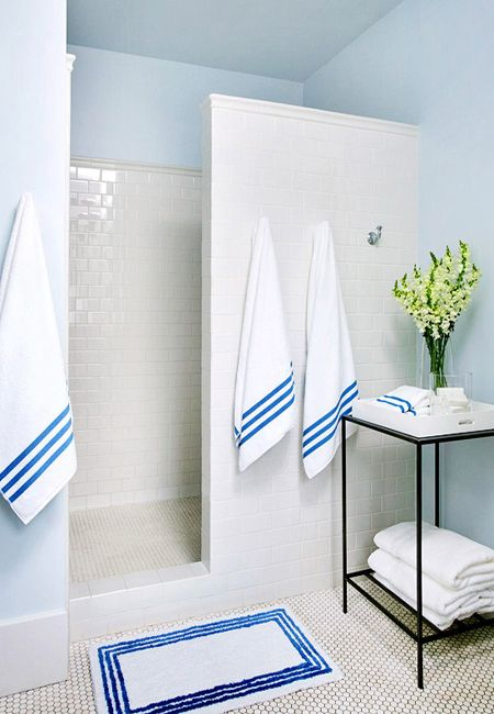Small bathroom remodel ideas on a budget shower in white subway tile. no glass doors to clean