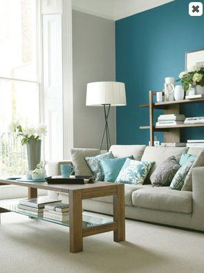 Teal accent wall in a light gray living room blue paint for Teal blue living room ideas