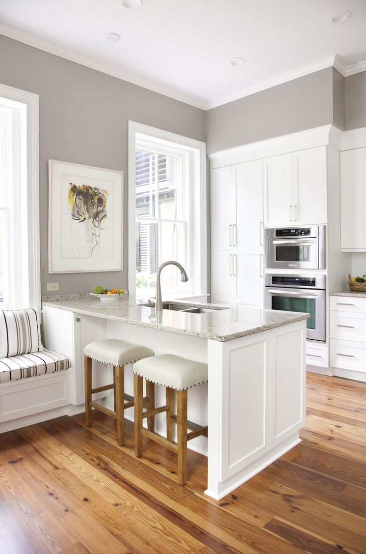 Cozy Small Kitchen Island Furniture White Cabinets, Gray Walls, Marble Countertops,  Wood Floors With Pottery Barn Stools