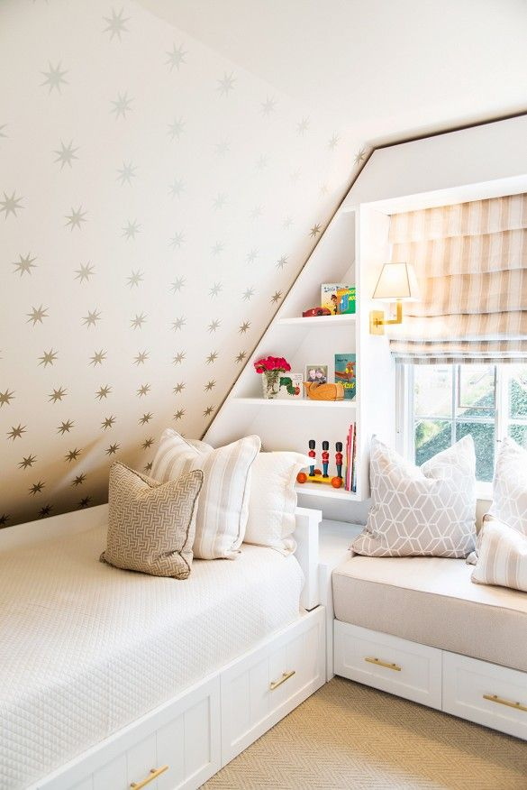 Small Attic Bedroom Storage Kid's Room With Sloped Ceiling, Gold Star Wallpaper, And Built-In Bookshelves