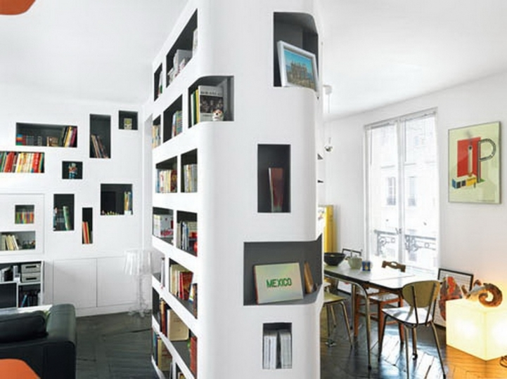 Small Studio Apartment White Wall And Ceiling Color Decoration With Bookcase On Wall And Black Flooring Color