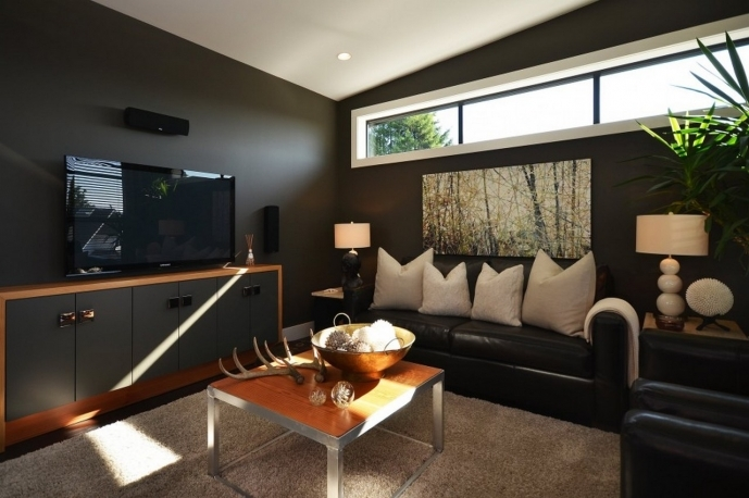Decorating Small Family Room Ideas With Dark Brown Wall Paint Design With Black Leather Sofa And TV 48