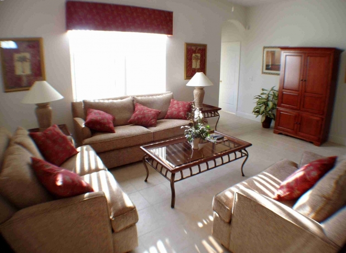 Small Room Decorating Ideas Family Room With Comfy Red Pillows Sofa Furniture Square Coffee Table 08